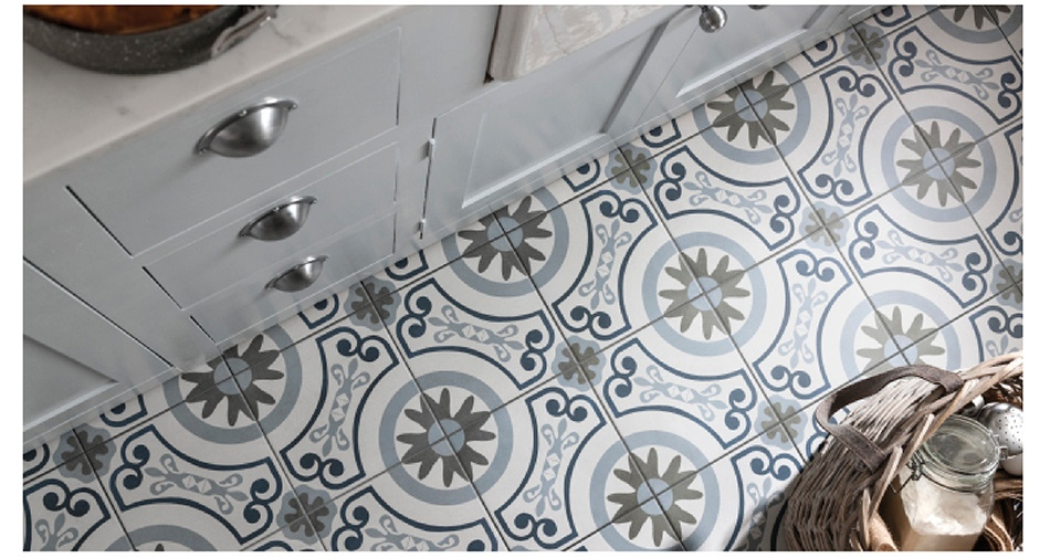 Havana patterned tiles on kitchen floor with white units.